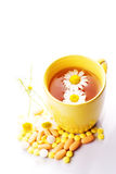 Tea with Chamomile  and pills Royalty Free Stock Image