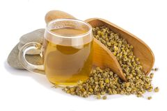 Tea with chamomile and stones Stock Image