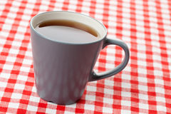 Tea on checkered tablecloth Stock Images