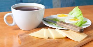 Tea, cheese and boiled egg Royalty Free Stock Photo