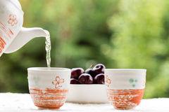 Tea and cherries Stock Image