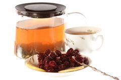 Tea with cherry jam and lemon isolated Royalty Free Stock Photo