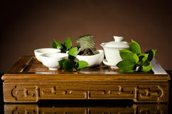 Tea china ware service. Horizontal photo, still life of the china waret and   on brown  background Royalty Free Stock Image