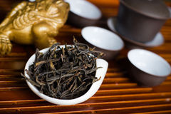 Tea chinese closeup. Chinese tea in pile on wooden table Royalty Free Stock Image