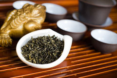 Tea chinese closeup. Chinese tea in pile on wooden table Stock Images