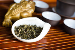 Tea chinese on wooden desk. Chinese tea in white cup Royalty Free Stock Photography