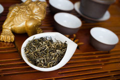 Tea chinese on wooden desk. Chinese tea in white cup Royalty Free Stock Image