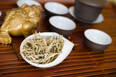 Tea chinese on wooden desk. Chinese tea in white cup Royalty Free Stock Photo