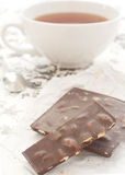 Tea and chocolate Stock Images