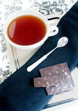 Tea and chocolate Stock Photos