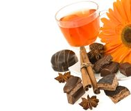 Tea, chocolate, anise, cinnamon, flower of gerbera Royalty Free Stock Images