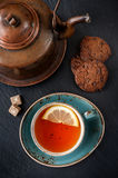 Tea with chocolate cookies for a tasty breakfast Stock Photography