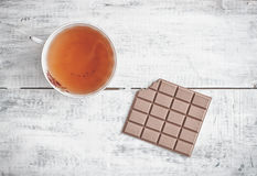 Tea and chocolate Stock Image