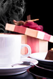 Tea, chocolate and gift Royalty Free Stock Photo