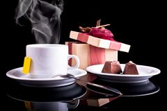 Tea, chocolate and gift Stock Photography