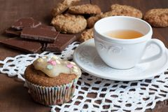 Tea with chocolate, oatmeal cookies and cupcakes.  Stock Photos