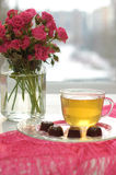 Tea, Chocolates And Pink Roses Stock Photo