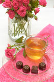Tea, chocolates and pink roses Stock Photos
