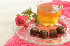 Tea, chocolates and pink roses Royalty Free Stock Photos