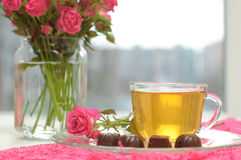 Tea, chocolates and pink roses Royalty Free Stock Image