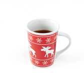 Tea in christmas cup on white. Background royalty free stock images