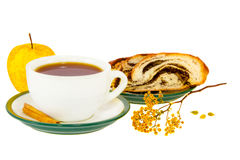 Tea cinnamon sticks roll with poppy seeds and apple. A tea cinnamon sticks roll with poppy seeds and apple Stock Images