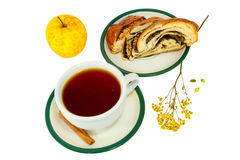 Tea cinnamon sticks roll with poppy seeds and apple. A tea cinnamon sticks roll with poppy seeds and apple Stock Image