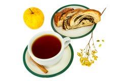 Tea cinnamon sticks roll with poppy seeds and apple Stock Image