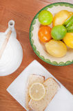 Tea and citrus by cake Stock Photos