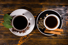 Tea and coffee centered on dark table Royalty Free Stock Images