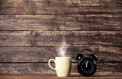 Tea or coffee cup and alarm clock Royalty Free Stock Photos