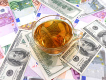 Tea or coffee cup on money wallpaper Royalty Free Stock Photography