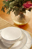 Tea or coffee cup and table with roses still life Stock Photos