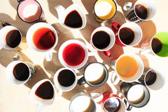 Tea, coffee and milk in cups from above Stock Images