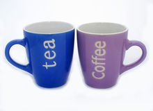 Tea and coffee mugs. With a white background Royalty Free Stock Images