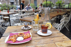 Tea, coffee, orange juice and cookies on a table Royalty Free Stock Photos