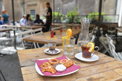 Tea, coffee, orange juice and cookies on a table Royalty Free Stock Photo