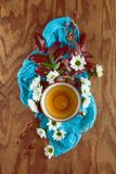 Tea or coffee pot wit flowers flat lay on a wooden background royalty free stock photo
