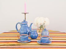 Tea or coffee set on table Stock Images