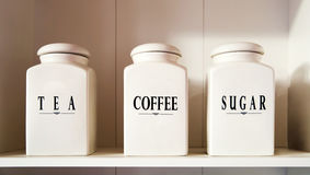 Tea coffee and sugar bowl in pantry shelf Royalty Free Stock Image