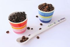 Tea and coffee. In two color cups Stock Photography