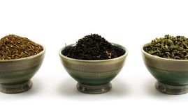 Tea collection. Three kinds of tea in cups on white background Stock Image