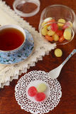 Tea with colored sugar candies. Blue cup with tea and colored sugar candies in a glass can Royalty Free Stock Photography