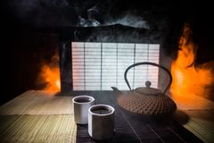 Tea concept. Japanese tea ceremony culture east beverage. Teapot and cups on table with bamboo leaves on sunset. Tea concept. Japanese tea ceremony culture east stock image