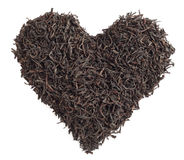 Tea concept. Tea leaves in the form of heart on a white background. Royalty Free Stock Photography