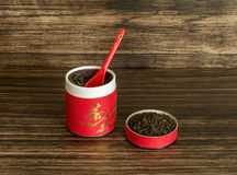Tea in the container. On a wooden background Stock Image
