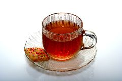 Tea and Cookie. Glass cup of  tea and cookie Stock Photo