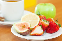 Tea,cookie,apple, lemon, fig and strawberries Royalty Free Stock Photography