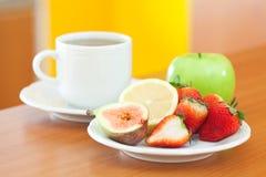 Tea,cookie,apple, lemon, fig and strawberries Royalty Free Stock Photo