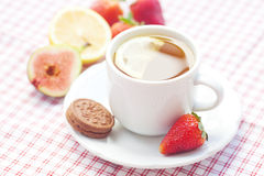 Tea,cookie, fig and strawberries Royalty Free Stock Photo